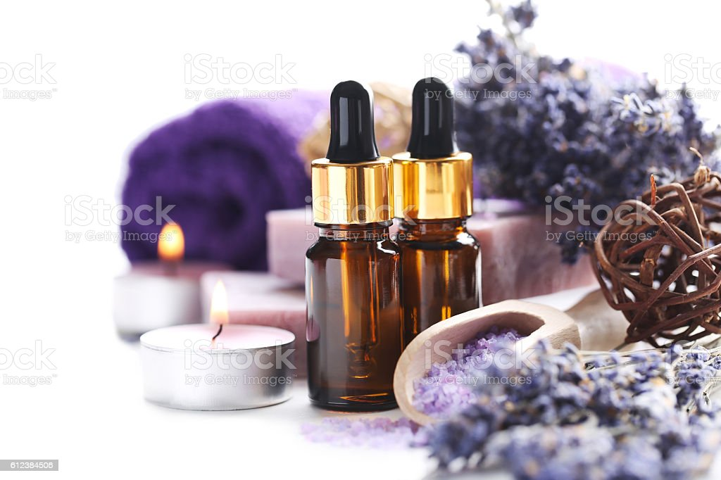 Lavender oil with soap and flowers on white background stock photo