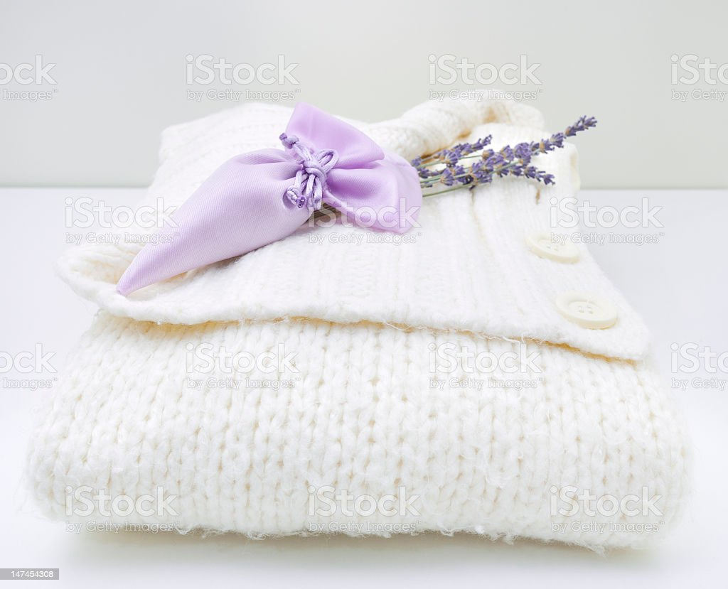 Lavender sachet on white sweater stock photo