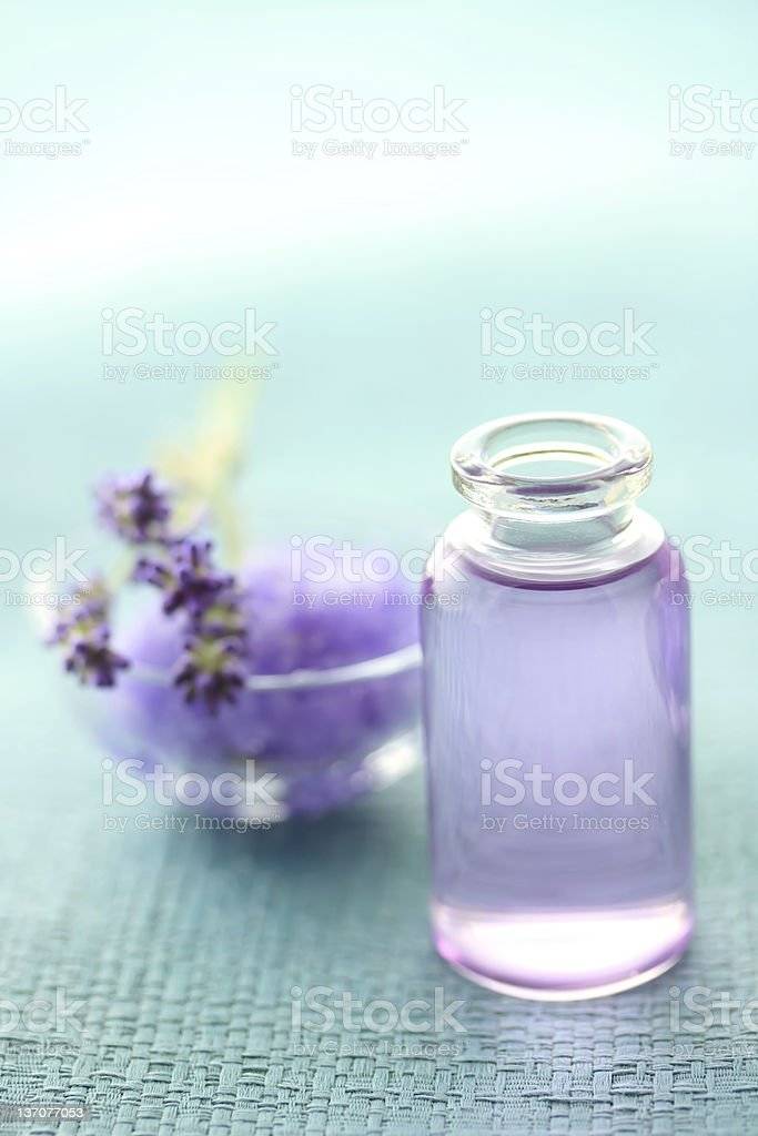 Lavender sprigs and aromatherapy oil royalty-free stock photo