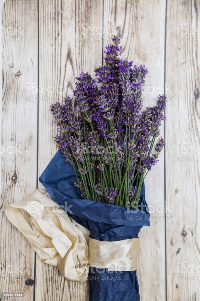 Lavender with silk ribbon on wooden background stock photo