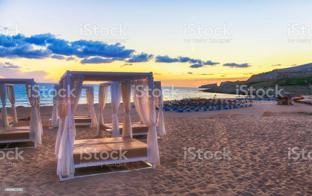 Lavish sunbeds at morning Majorca beach stock photo