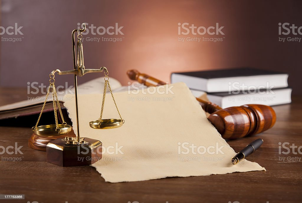 Law and justice stuff on wood table, dark background royalty-free stock photo