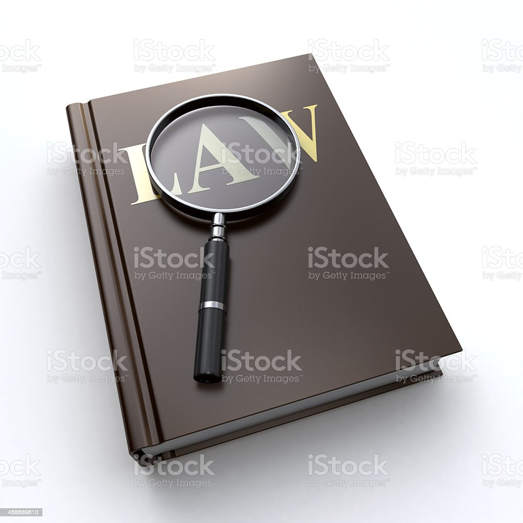 Law book and a magnifier stock photo