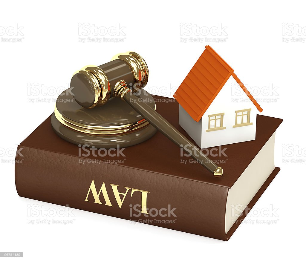 Law book with gavel and small house on top royalty-free stock photo