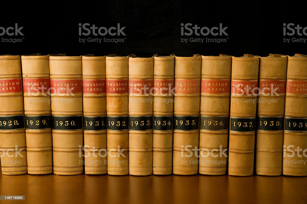Law books from 1928-1939 against a black background stock photo