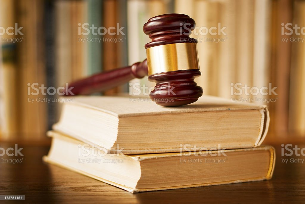Law books with a judges gavel royalty-free stock photo