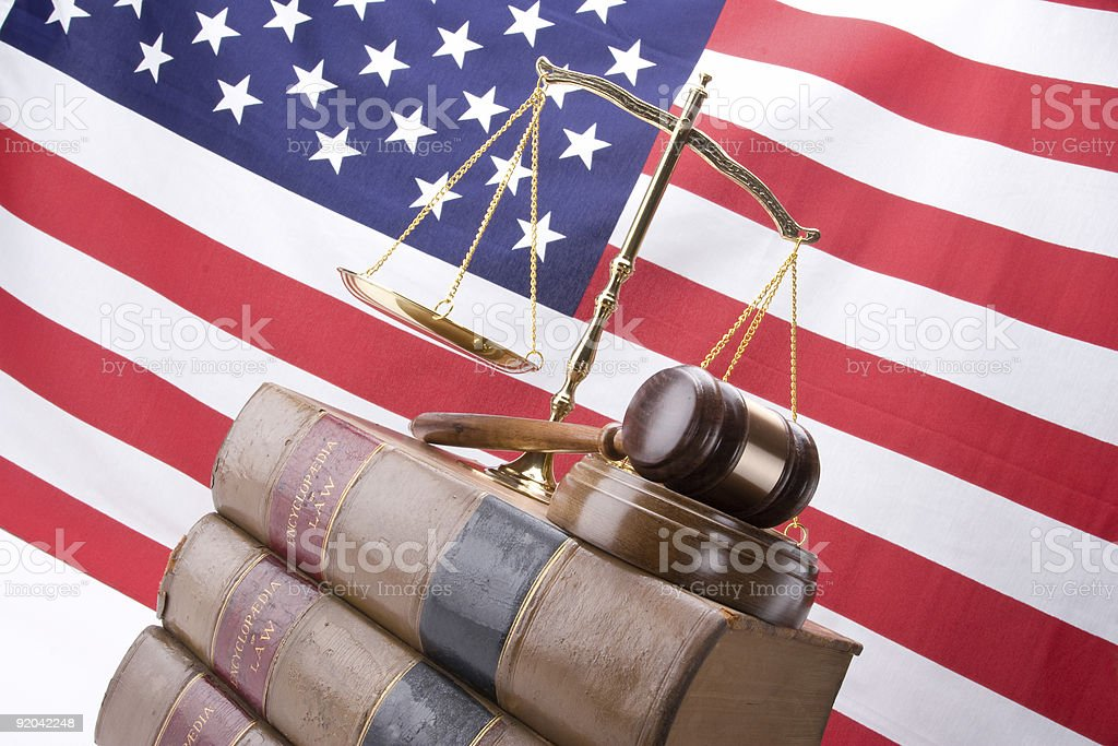 Law books with gavel and scales of justice with flag royalty-free stock photo