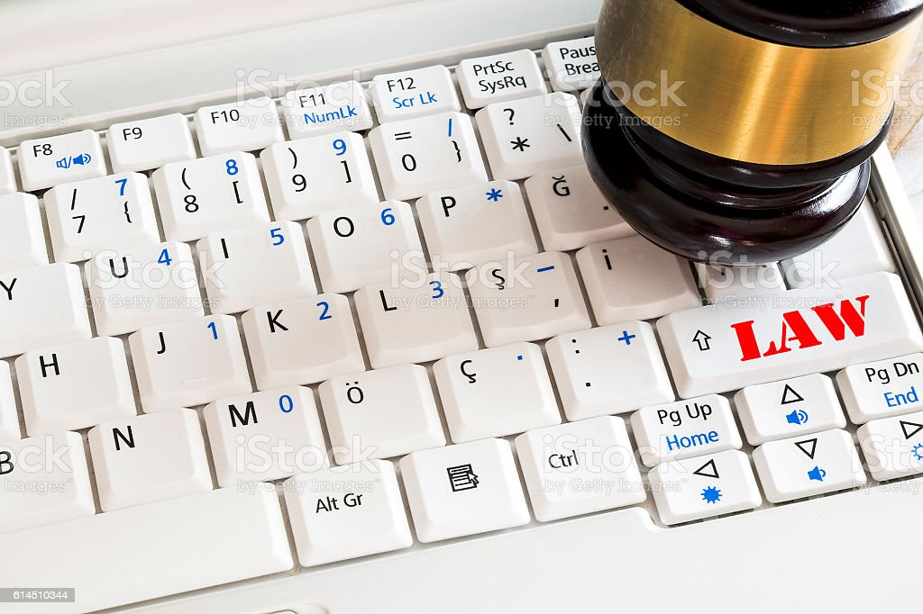 Law concept. Close up of judge gavel and laptop stock photo