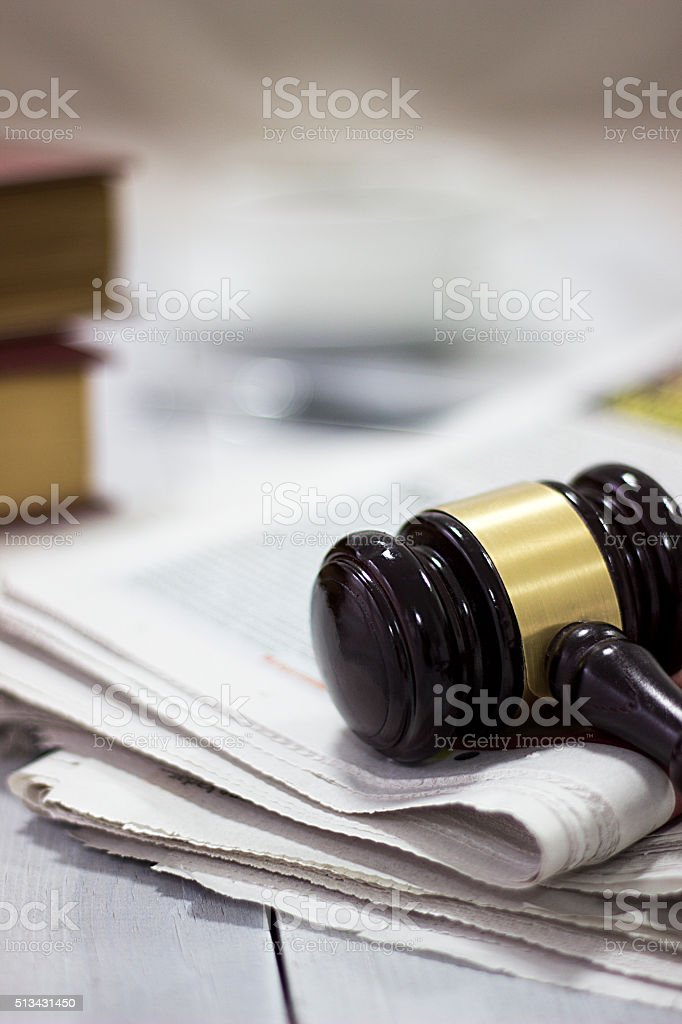 Law concept, gavel, newspaper and cup of coffee stock photo