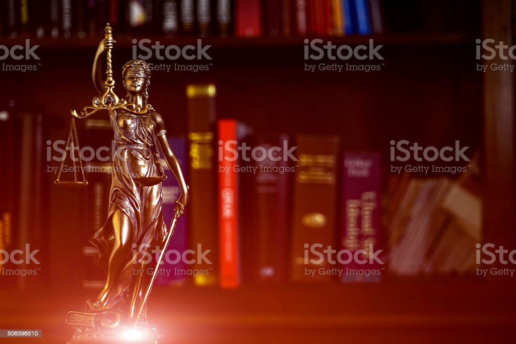 Law concept image with Scales of justice with law books stock photo