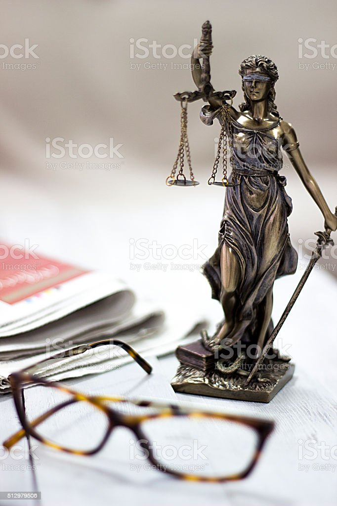 Law concept, statue, gavel, newspaper and glasses stock photo