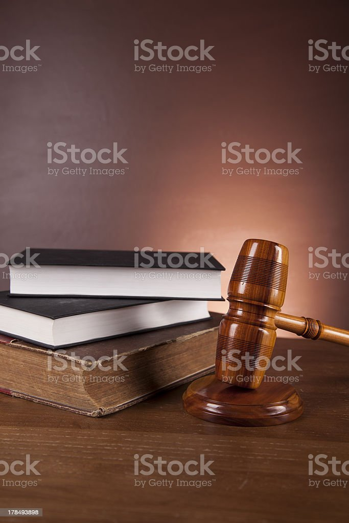 Law concept with wooden table and dark background royalty-free stock photo