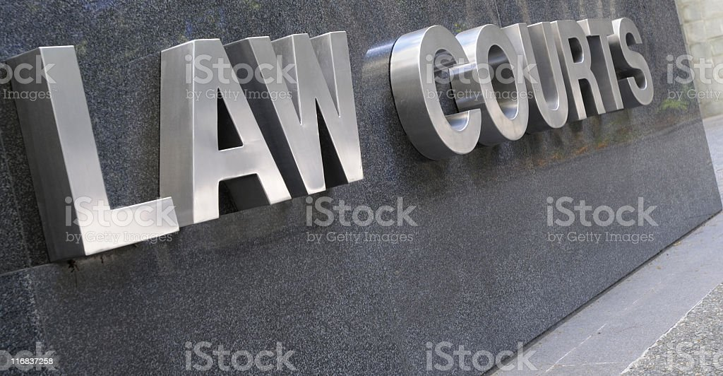 Law Courts sign in stainless steel lettering royalty-free stock photo