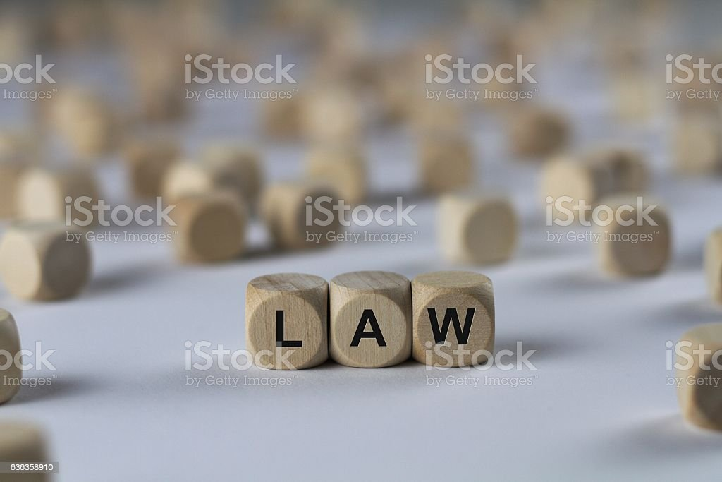 law - cube with letters, sign with wooden cubes stock photo