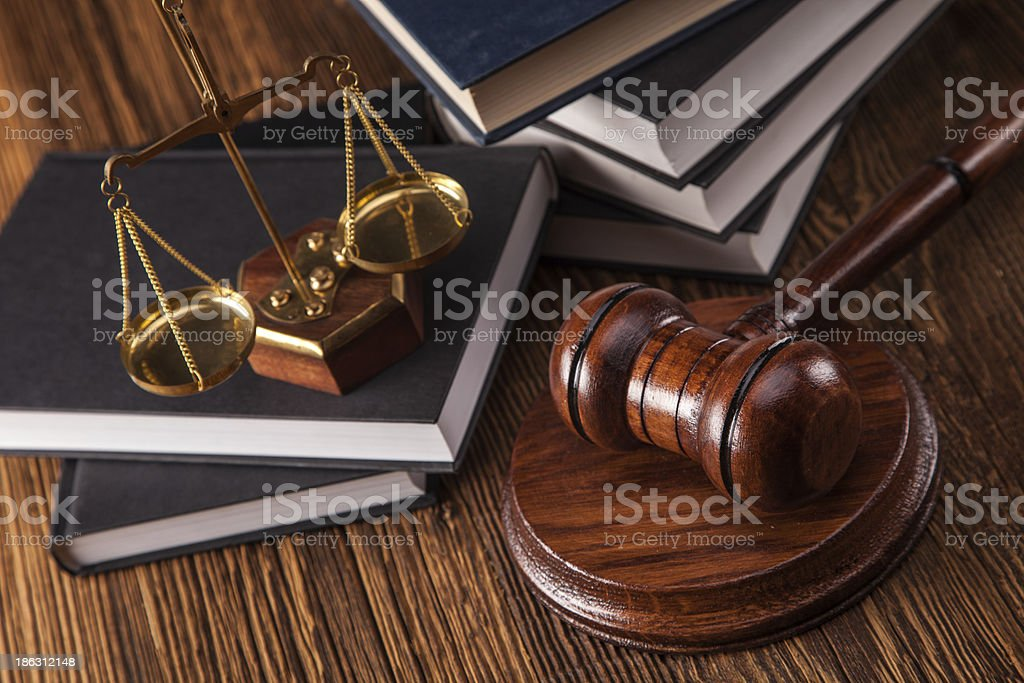 A law desk with a gavel and weighing scales royalty-free stock photo