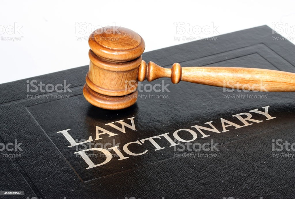 Law dictionary and gavel on white background stock photo
