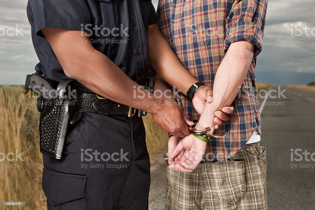 Law Enforcement Arrest on Roadside royalty-free stock photo