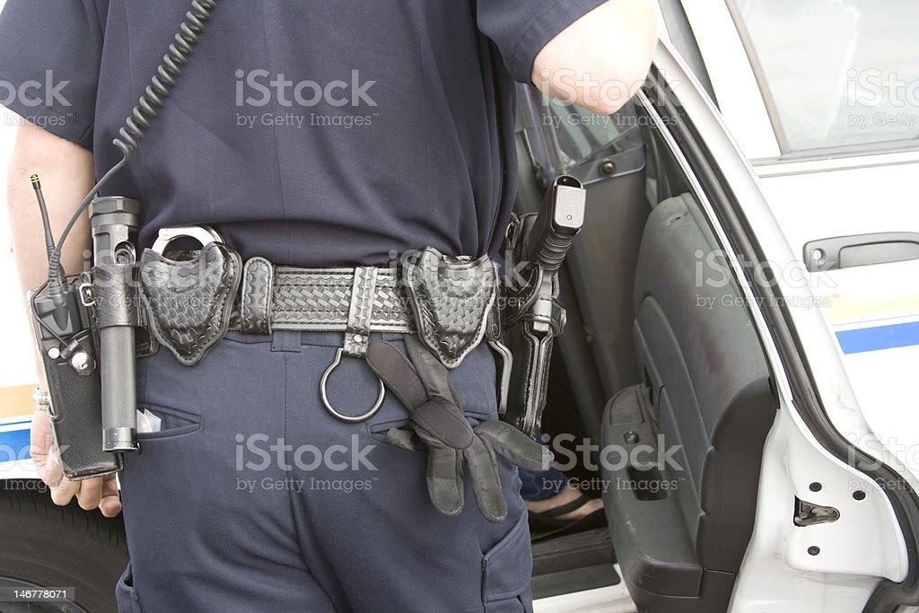 Law enforcement officer near car stock photo