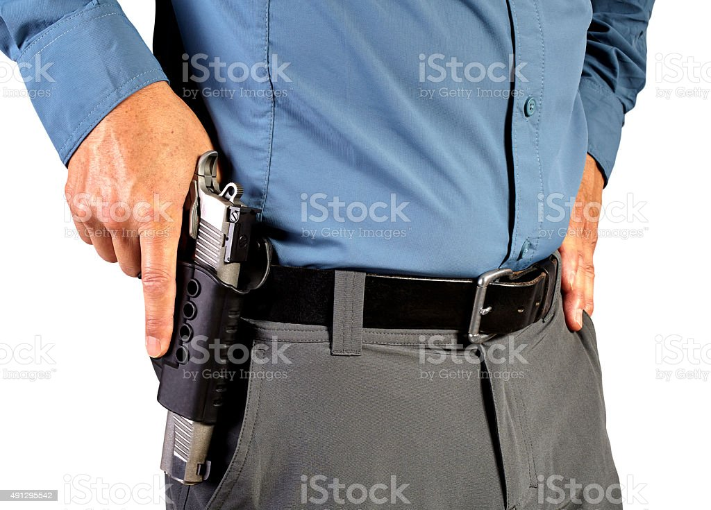 Law Enforcement Professional Man with Holstered Gun Weapon stock photo