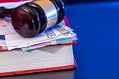 Law gavel with book and euro money - reflection on