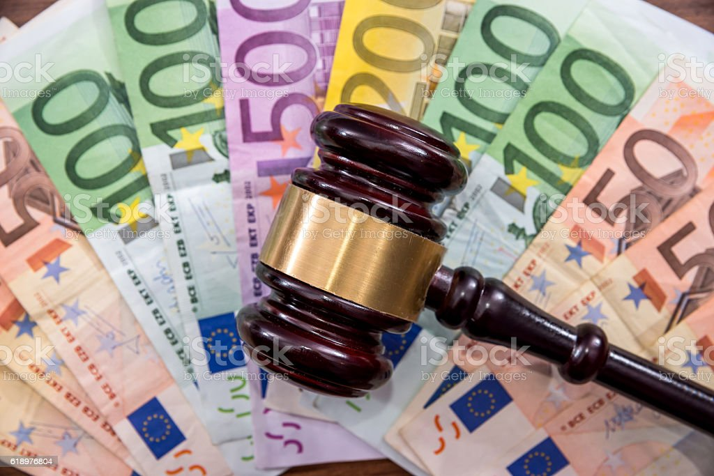 Law gavel with euro on wooden desk stock photo