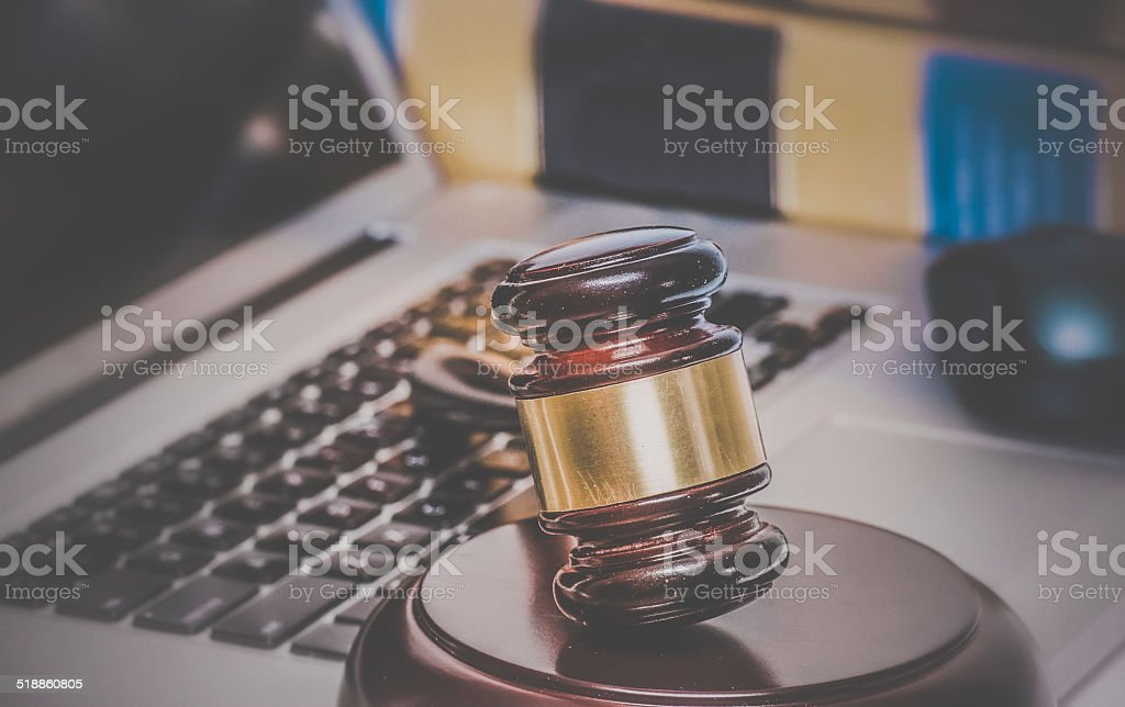 Law legal issue concept image gavel on computer stock photo