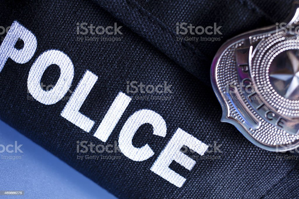 Law: Police bulletproof vest and badge. stock photo