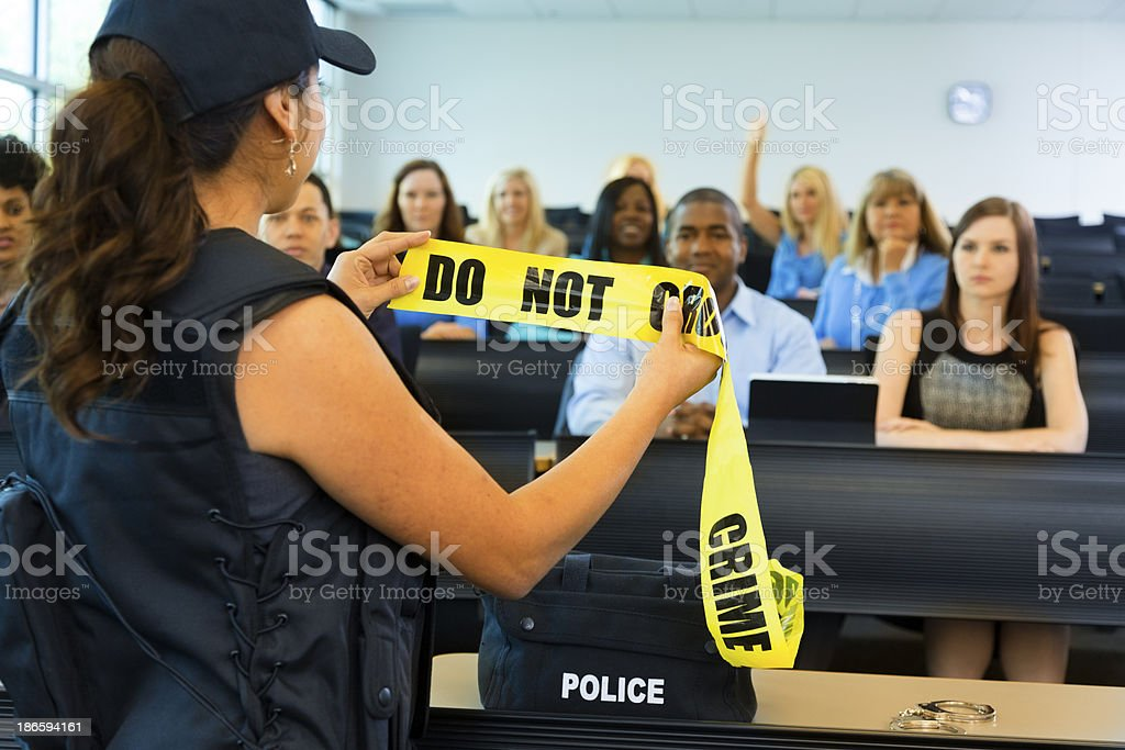 Law:  Policewoman speaks to police cadets. stock photo