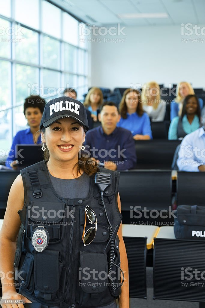 Law:  Policewoman speaks to potential police cadets. stock photo