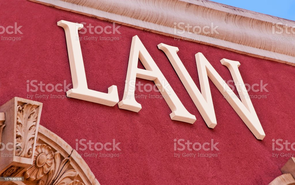 Law Sign on Stucco Wall stock photo