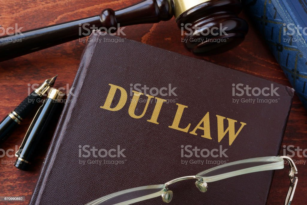 DUI Law title on a book and gavel. stock photo
