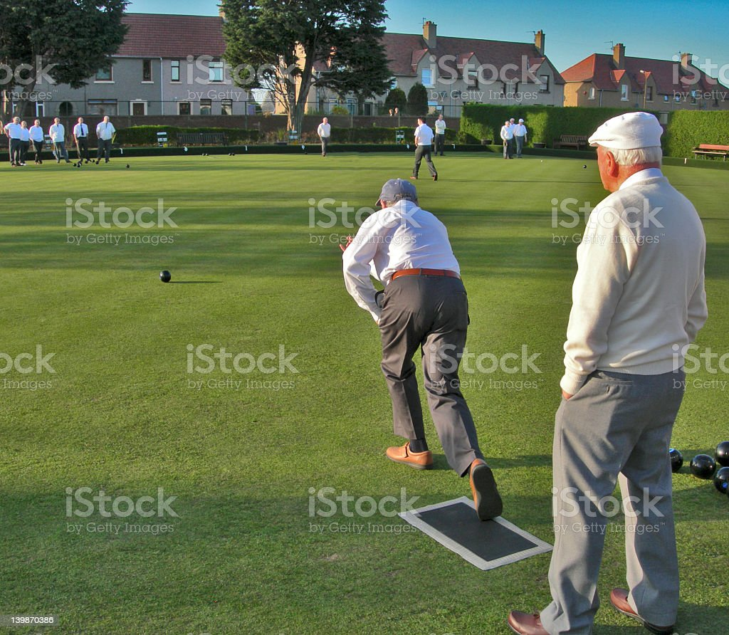 Lawn Bowler playing his shot stock photo