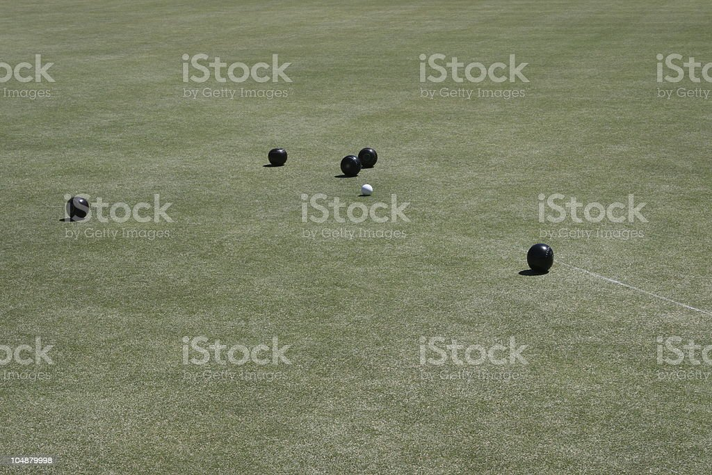 Lawn bowling game in progress royalty-free stock photo