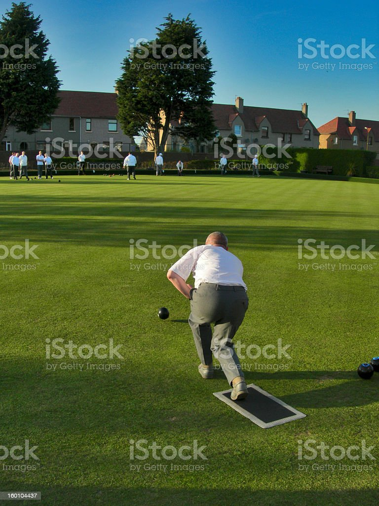 Lawn Bowls Team Player playing his shot stock photo