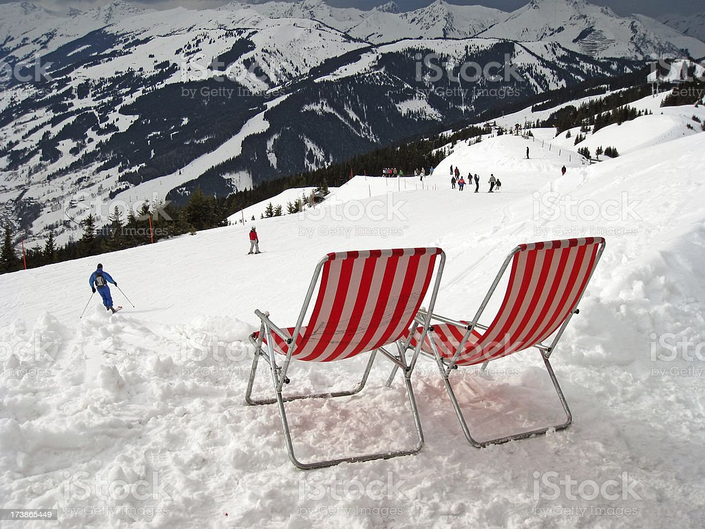 Lawn chairs overlooking Ski Slope royalty-free stock photo