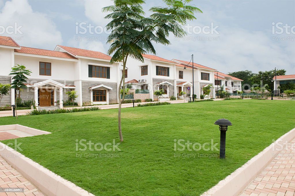 Lawn in front of bungalows stock photo