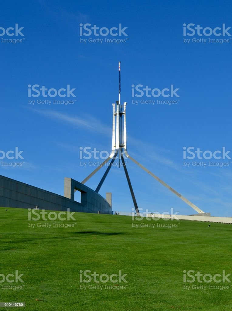 Lawn leading to spire on Parliament House Canberra Australia stock photo
