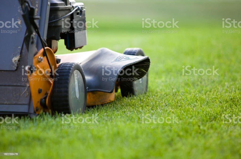 Lawn Mower Discharging Grass stock photo