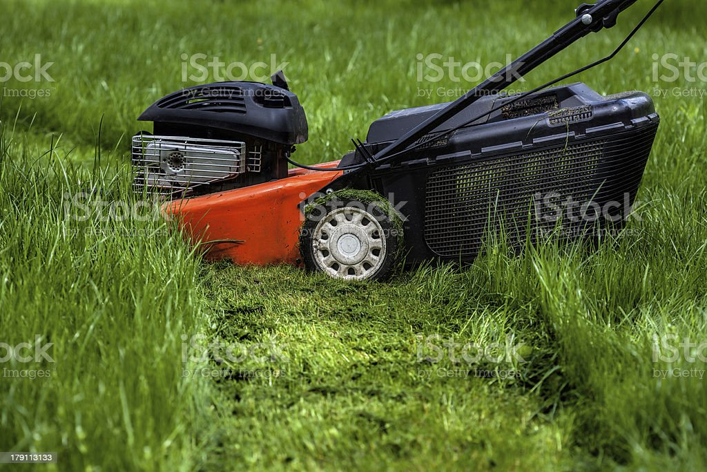 Lawn mower in garden royalty-free stock photo