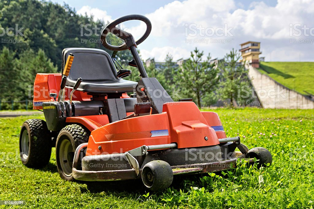 Lawn mower in the grass stock photo