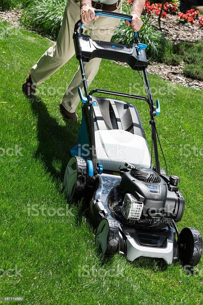 Lawn mower on green lawn stock photo