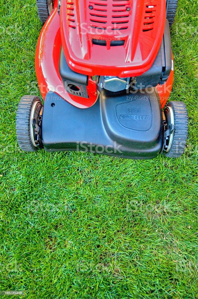 Lawn mower on lush grass royalty-free stock photo