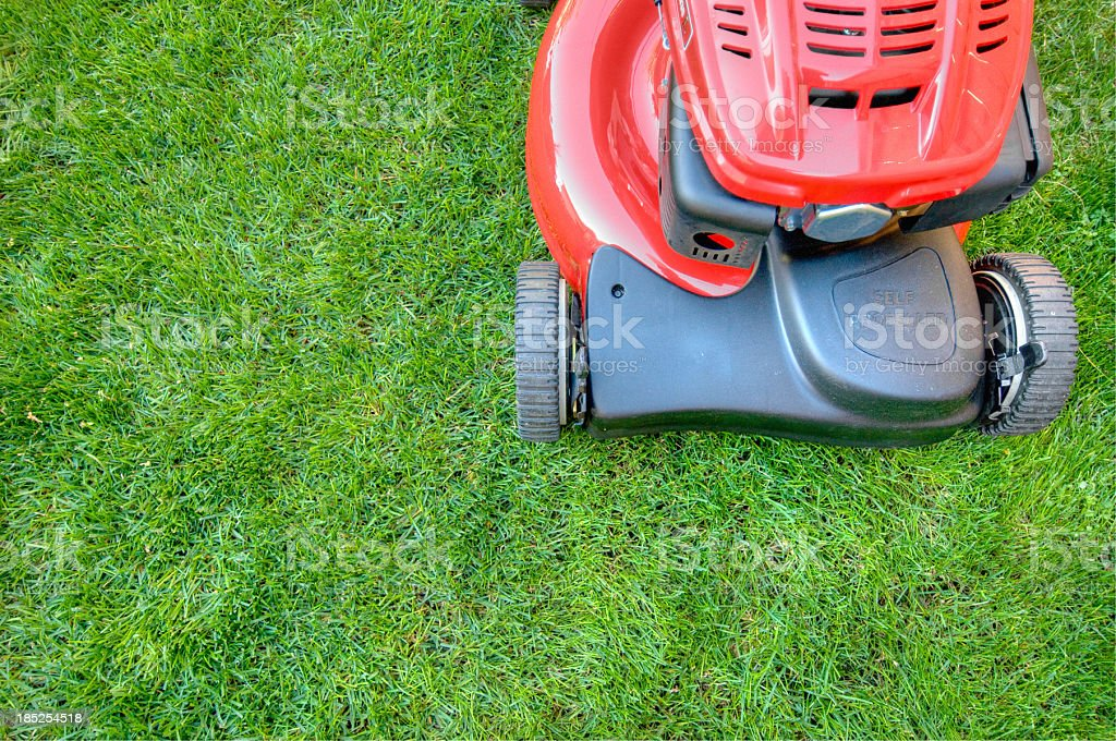 Lawn mower on lush grass stock photo