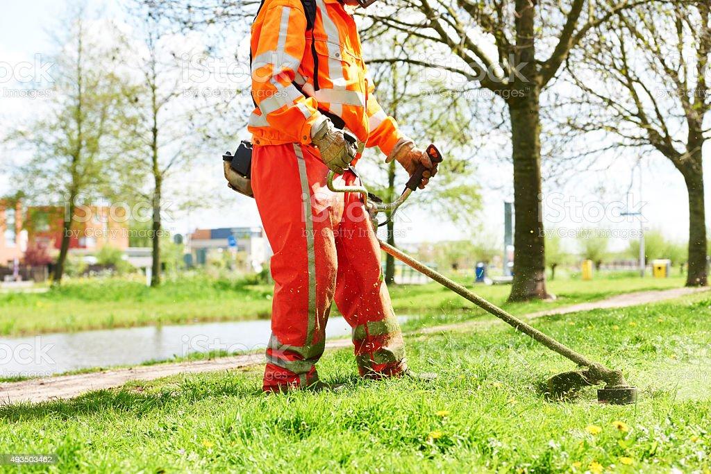 lawn mower worker man cutting grass stock photo