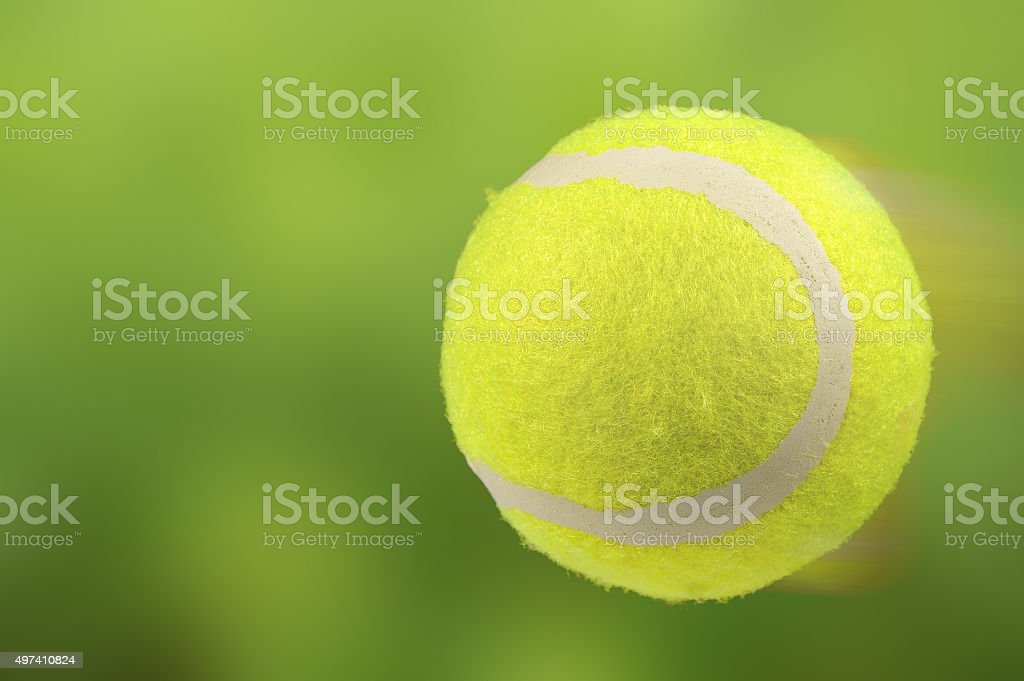 Lawn Tennis Ball in Motion on Green Background stock photo