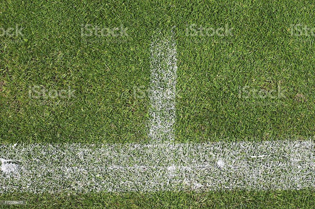 Lawn tennis baseline T chalk on grass royalty-free stock photo