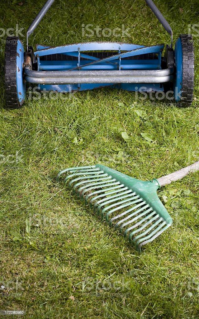 Lawnmower and rake stock photo