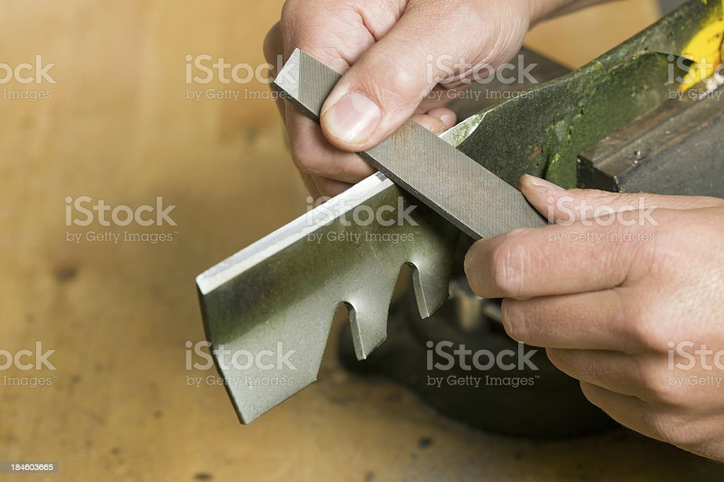 Lawnmower Blade Sharpening with File stock photo