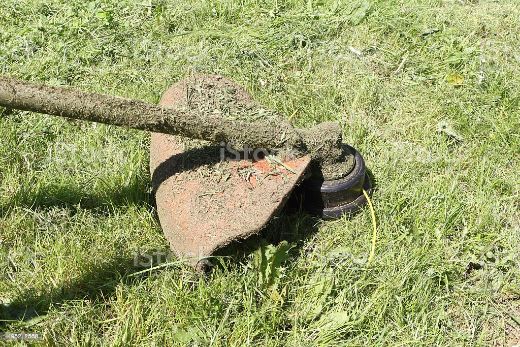 Lawnmower in a grass stock photo