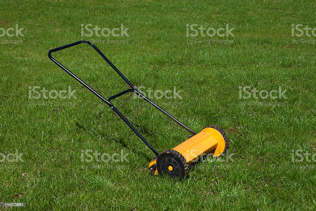 lawn-mower on green grass stock photo
